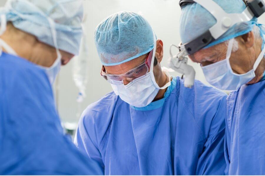 Doctors completing surgical procedure