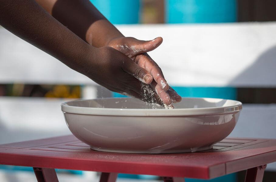 Hands using talcum powder