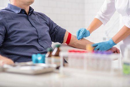 Man Getting Blood Drawn in Lab