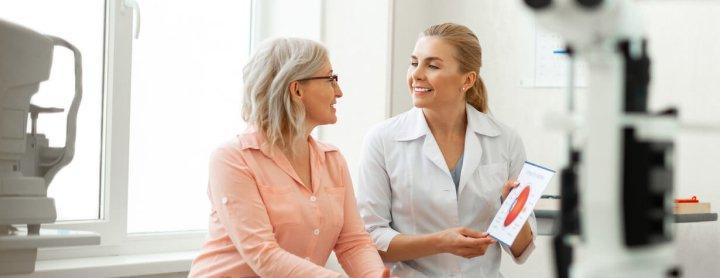 Elderly woman speaks with eye doctor