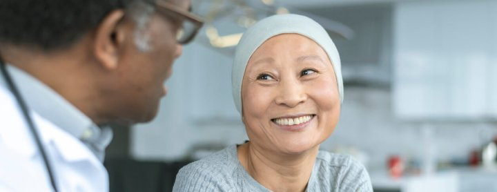 Cancer patient and doctor having discussion