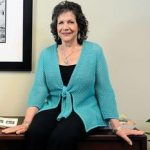 Carole Herman at desk