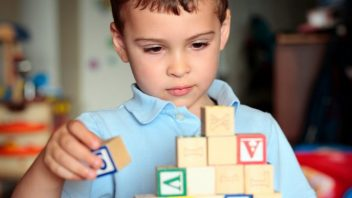 Autistic boy building blocks