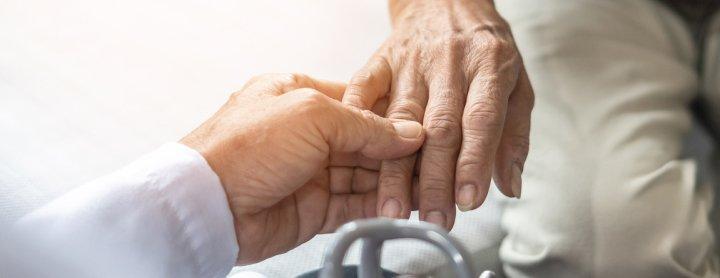 Doctor inspecting patient's hand