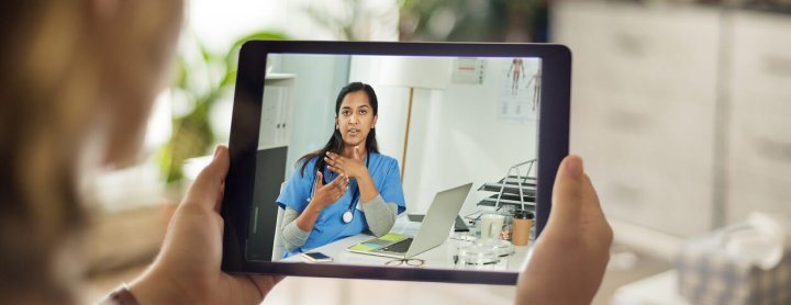 Patient using tablet for telemedicine visit