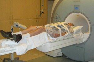 man laying down in a MRI machine
