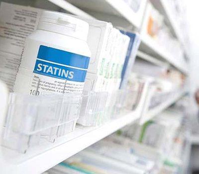 Statins bottle on pharmacy shelf