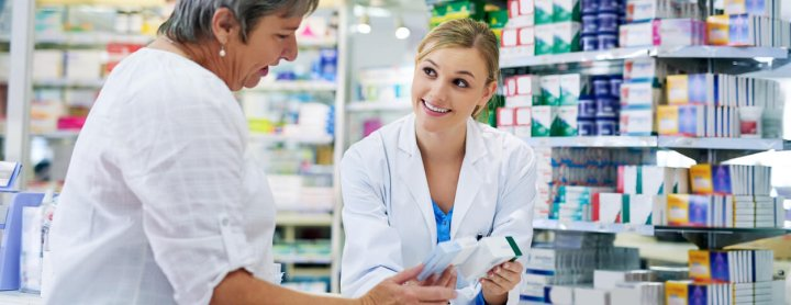 Pharmacist advises customer on prescription