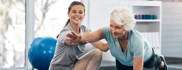 Elderly woman receiving physical therapy