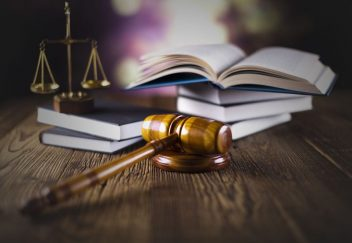 Legal textbooks, justice scales and gavel