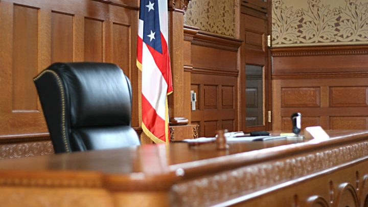 U.S. courtroom with flag