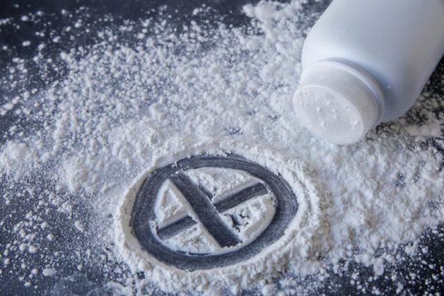 Spilled talcum powder on dark surface
