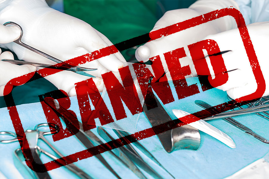"""Doctor holding scalpel with """"banned"""" text"""