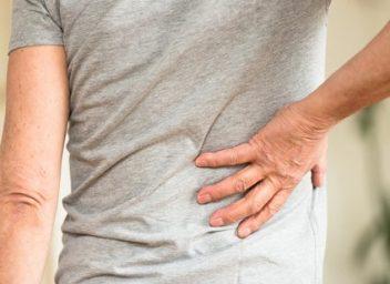 Man Grabbing Back in Pain