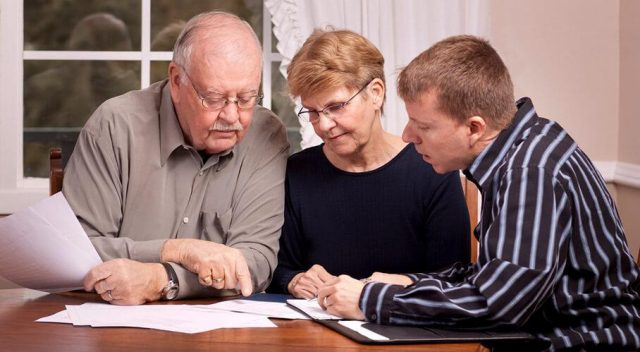 Older couple receiving help with long-term care planning