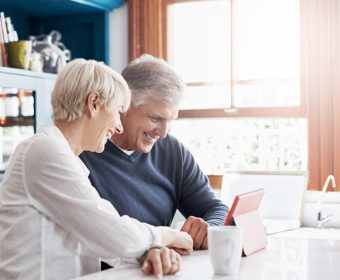Cheerful couple on tablet