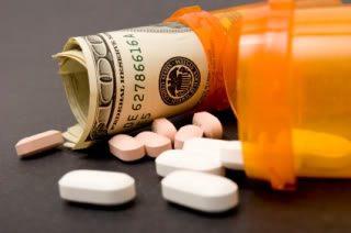 Prescription bottles holding pills and money