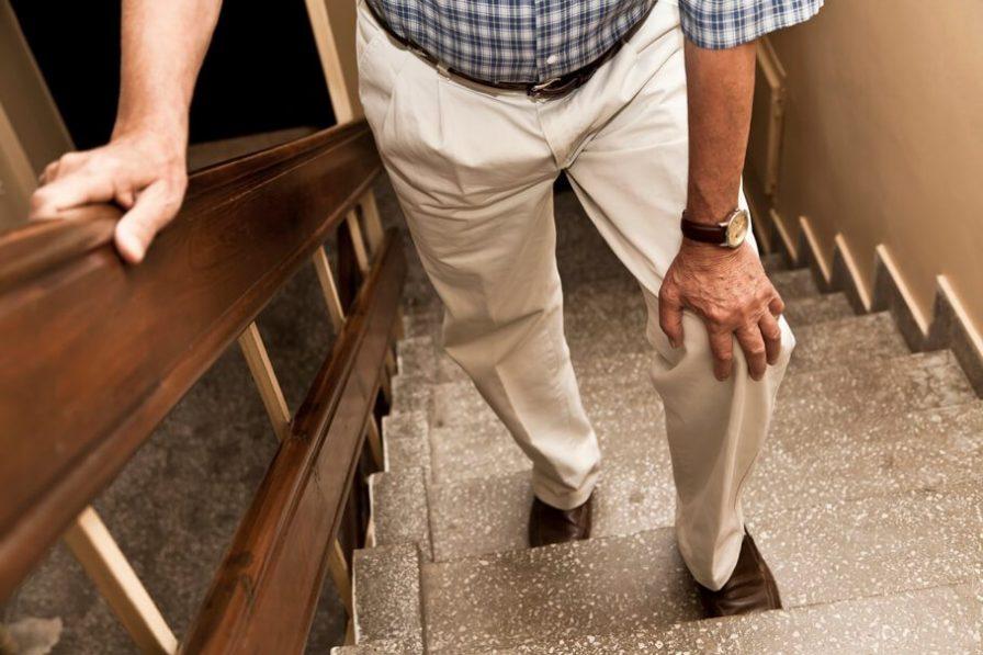 Elderly man experiencing knee pain