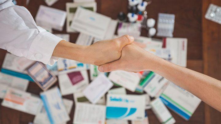 Shaking Hands over Prescription Drugs