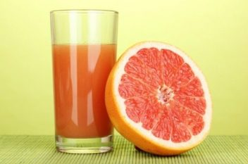 Grapefruit and cup of juice