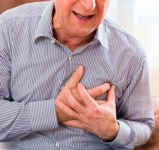 man clutching chest in pain
