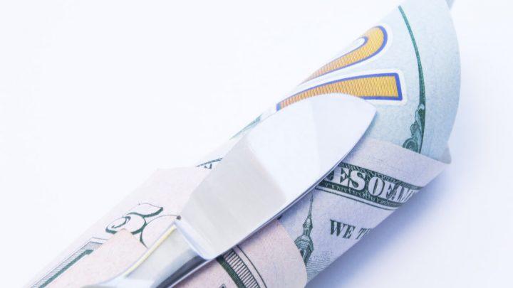 scalpel on top of money