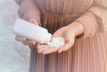 Woman pouring talcum powder