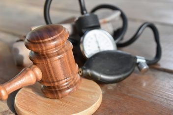 gavel and blood pressure monitor