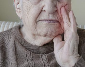 Elderly Man Clenching Jaw in Pain