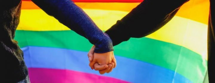 lgbtq couple holding hands