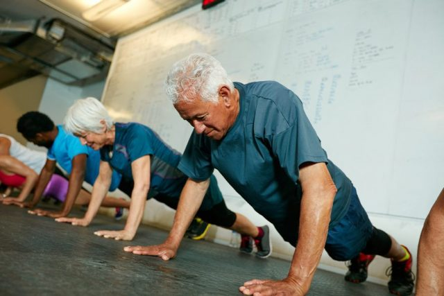 older man doing a push up