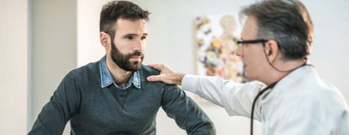 Younger male consulting a doctor