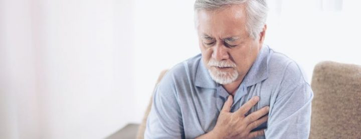 Elderly man experiencing a heart attack