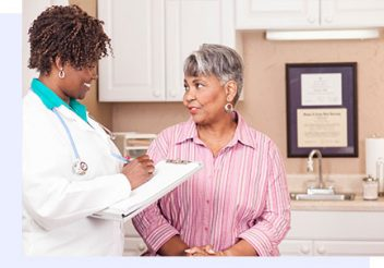middle aged woman consulting a doctor