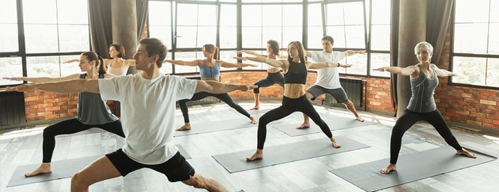 Men and women doing yoga in a studio
