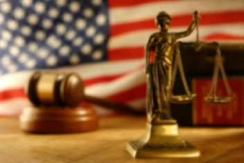 justice scales, gavel, and U.S. flag
