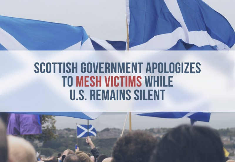 Crowd holding Scottish flags