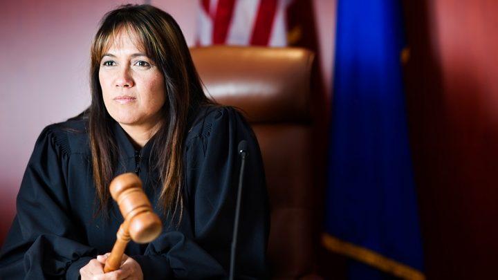 female judge holding a gavel