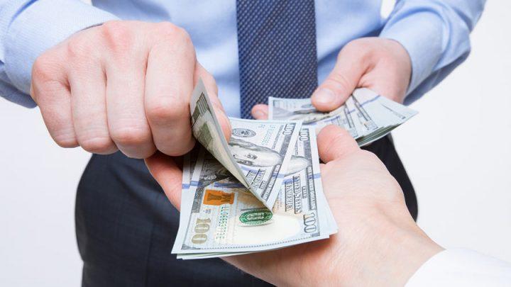 businessmen exchanging money