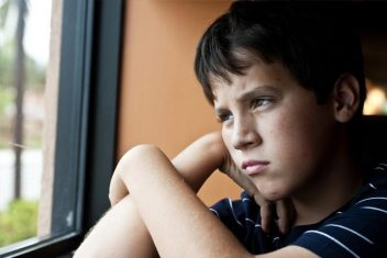 young boy looking out a window