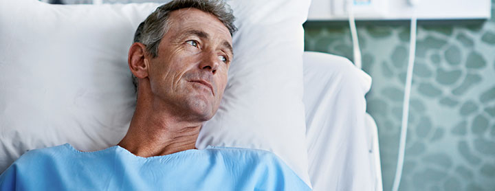 Older man resting in hospital bed