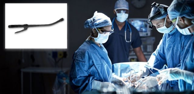 Surgeons using surgical stapler during surgery