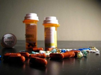 Pill bottles and various pills