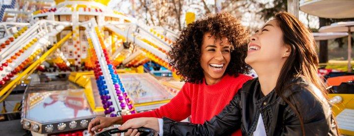 Women enjoying a fair ride
